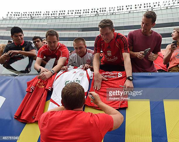 Brendan Rodgers manager of Liverpool signs autographs after a training session before the first game in the Guinness International Champions Cup...