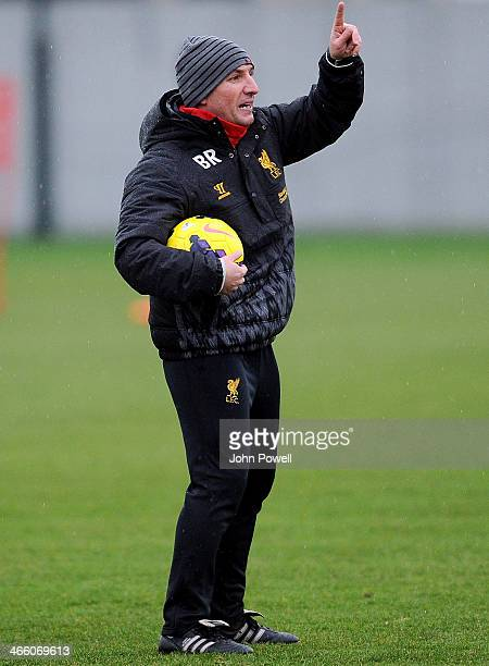 Brendan Rodgers manager of Liverpool speaks to his players during a training session at Melwood Training Ground on January 31 2014 in Liverpool...