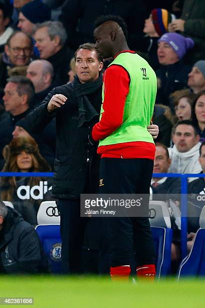 Brendan Rodgers manager of Liverpool speaks to Mario Balotelli of Liverpool during the Capital One Cup SemiFinal second leg between Chelsea and...