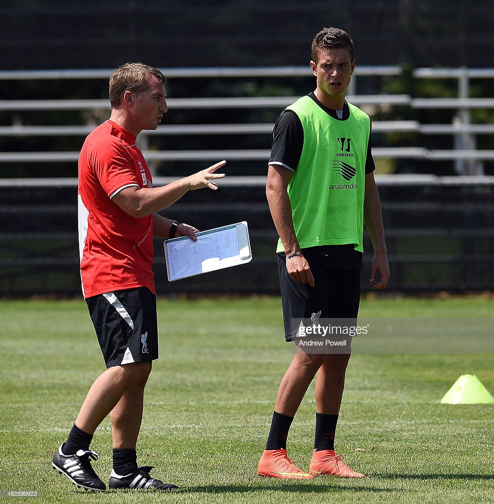 Brendan Rodgers manager of Liverpool talking with Kristoffer Peterson during a training session at Harvard University on July 22, 2014 in Cambridge, Massachusetts.