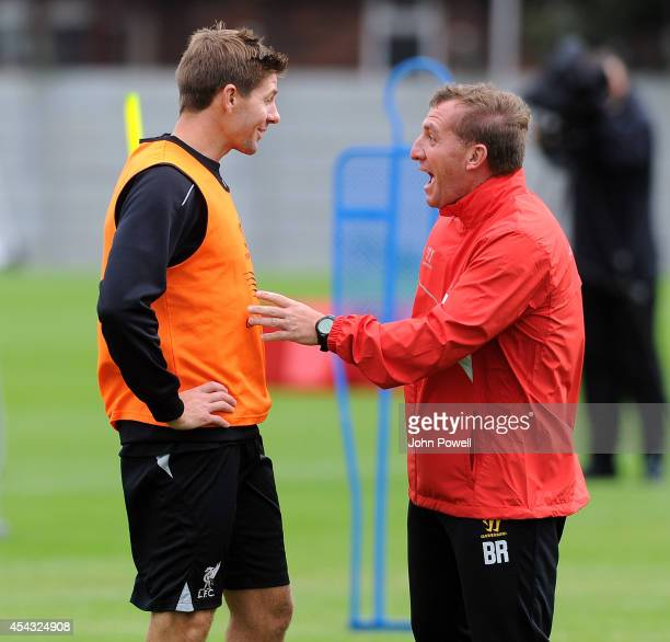 Brendan Rodgers manager of Liverpool talking with Steven Gerrard during a training session at at Melwood Training Ground on August 29 2014 in...