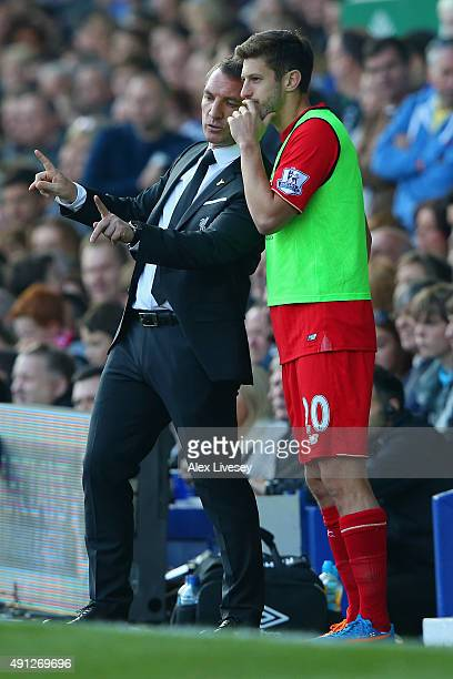Brendan Rodgers manager of Liverpool talks tactics with Adam Lallana of Liverpool during the Barclays Premier League match between Everton and...