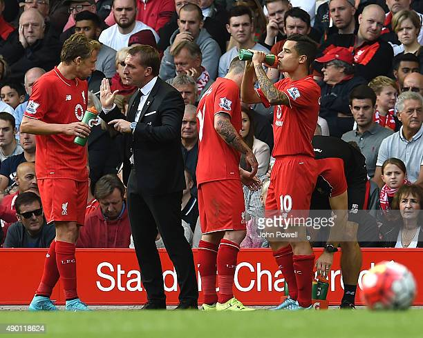 Brendan Rodgers manager of Liverpool talks to Lucas Leiva of Liverpool during the Barclays Premier League match between Liverpool and Aston Villa on...