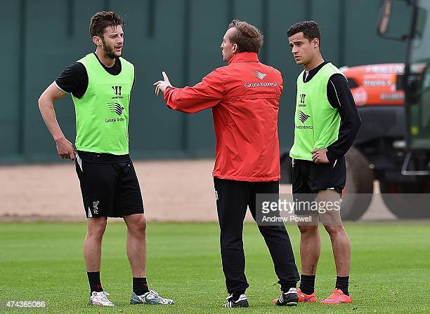 Brendan Rodgers manager of Liverpool talks with Adam Lallana and Philippe Coutinho during a training session at Melwood Training Ground on May 22...