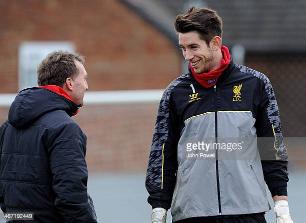 Brendan Rodgers manager of Liverpool talks with Brad Jones during a training session at Melwood Training Ground on February 6 2014 in Liverpool...