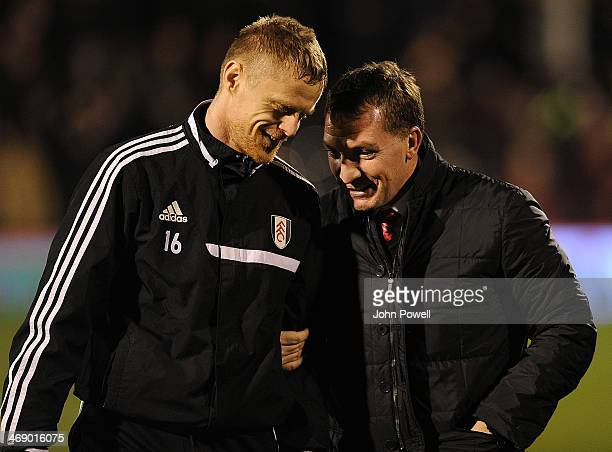 Brendan Rodgers manager of Liverpool talks with Damien Duff of Fulham before the Barclays Premier Leauge match between Fulham and Liverpool at Craven...