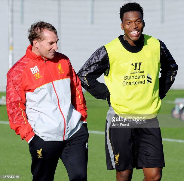 Brendan Rodgers manager of Liverpool talks with Daniel Sturridge during a training session at Melwood Training Ground on November 7 2013 in Liverpool...