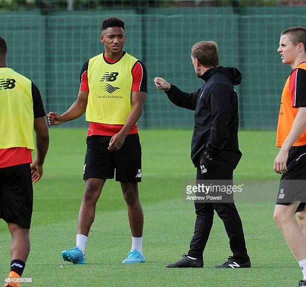Brendan Rodgers manager of Liverpool talks with Joe Gomez during a training session at Melwood Training Ground on August 15 2015 in Liverpool England