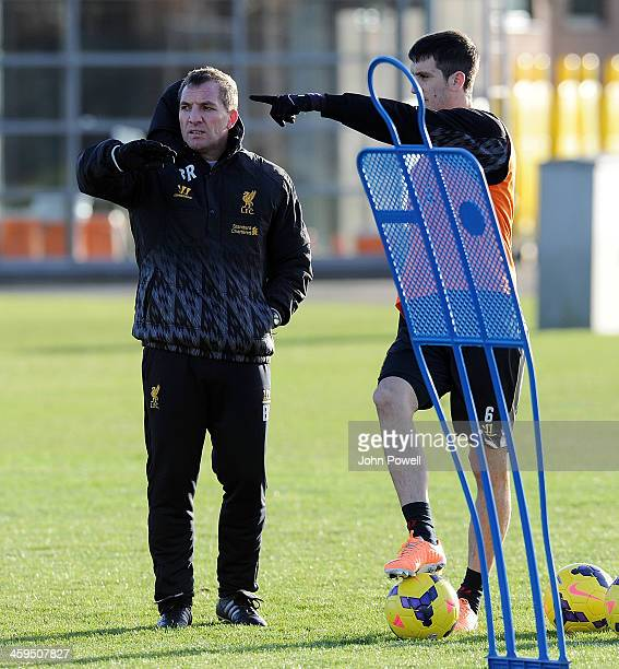 Brendan Rodgers manager of Liverpool talks with Luis Alberto during a training session at Melwood Training Ground on December 27 2013 in Liverpool...