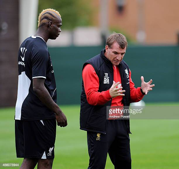 Brendan Rodgers manager of Liverpool talks with Mario Balotelli during a training session at Melwood Training Ground on September 25 2014 in...