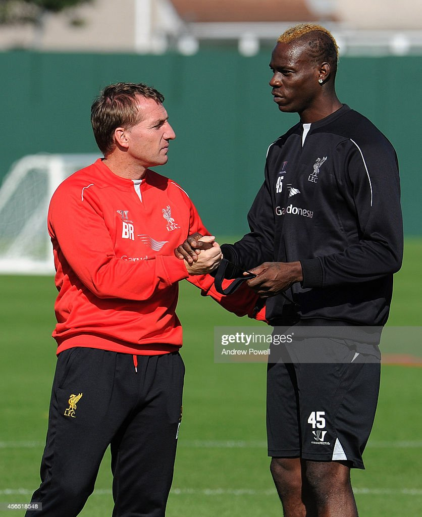 Brendan Rodgers manager of Liverpool talks with Mario Balotelli during a training session at Melwood Training Ground on October 2, 2014 in Liverpool, England.
