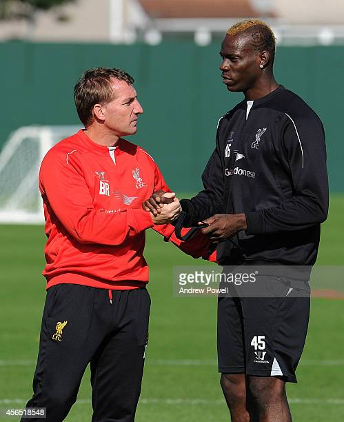 Brendan Rodgers manager of Liverpool talks with Mario Balotelli during a training session at Melwood Training Ground on October 2 2014 in Liverpool...