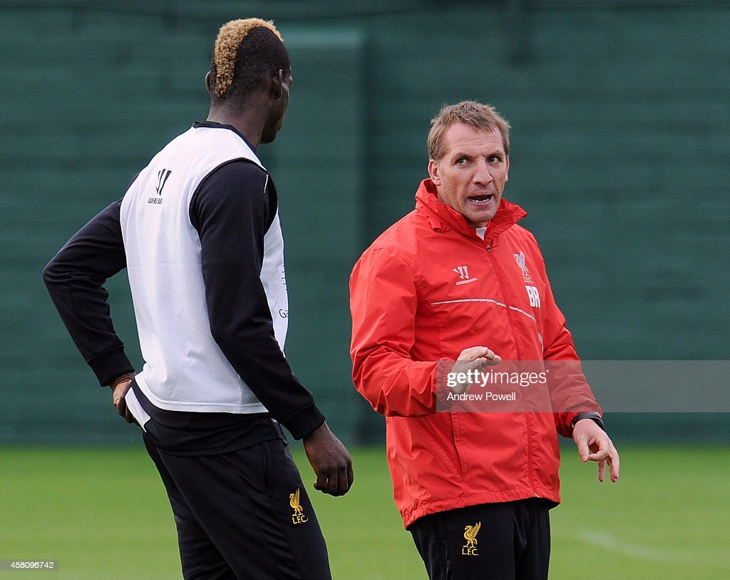Brendan Rodgers manager of Liverpool talks with Mario Balotelli during a training session at Melwood Training Ground on October 30, 2014 in Liverpool, England.