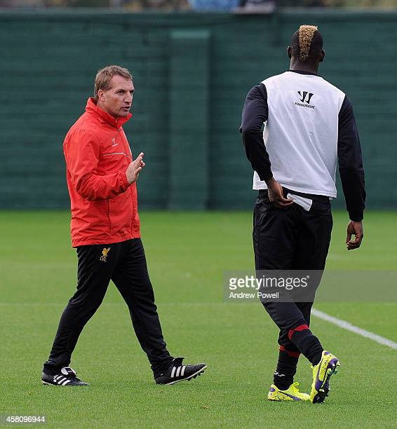 Brendan Rodgers manager of Liverpool talks with Mario Balotelli during a training session at Melwood Training Ground on October 30 2014 in Liverpool...