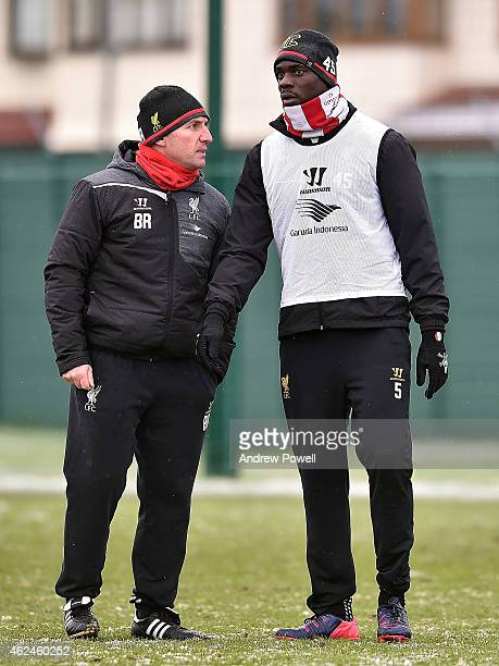 Brendan Rodgers manager of Liverpool talks with Mario Balotelli during a training session at Melwood Training Ground on January 29 2015 in Liverpool...