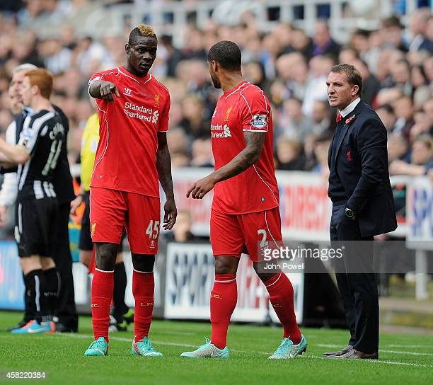 Brendan Rodgers manager of Liverpool talks with Mario Balotelli and Glen Johnson during the Barclays Premier League match between Newcastle United...