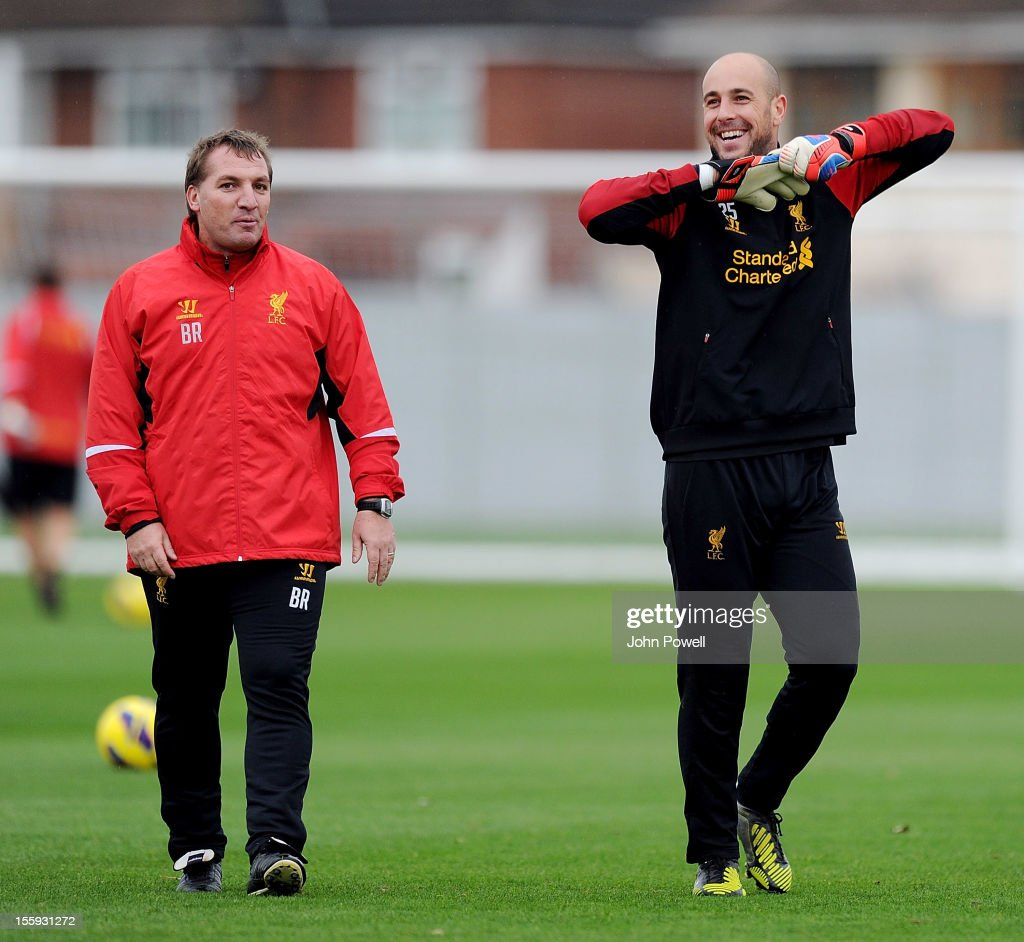 Brendan Rodgers, manager of Liverpool, talks with Pepe Reina during a training session at Melwood Training Ground on November 9, 2012 in Liverpool, England.