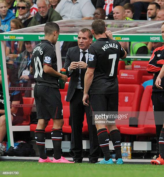 Brendan Rodgers manager of Liverpool talks with Philippe Coutinho and James Milner of Liverpool during the Barclays Premier League match between...