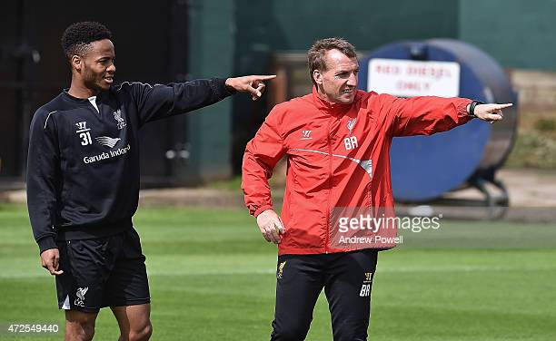 Brendan Rodgers manager of Liverpool talks with Raheem Sterling during a training session at Melwood Training Ground on May 8 2015 in Liverpool...