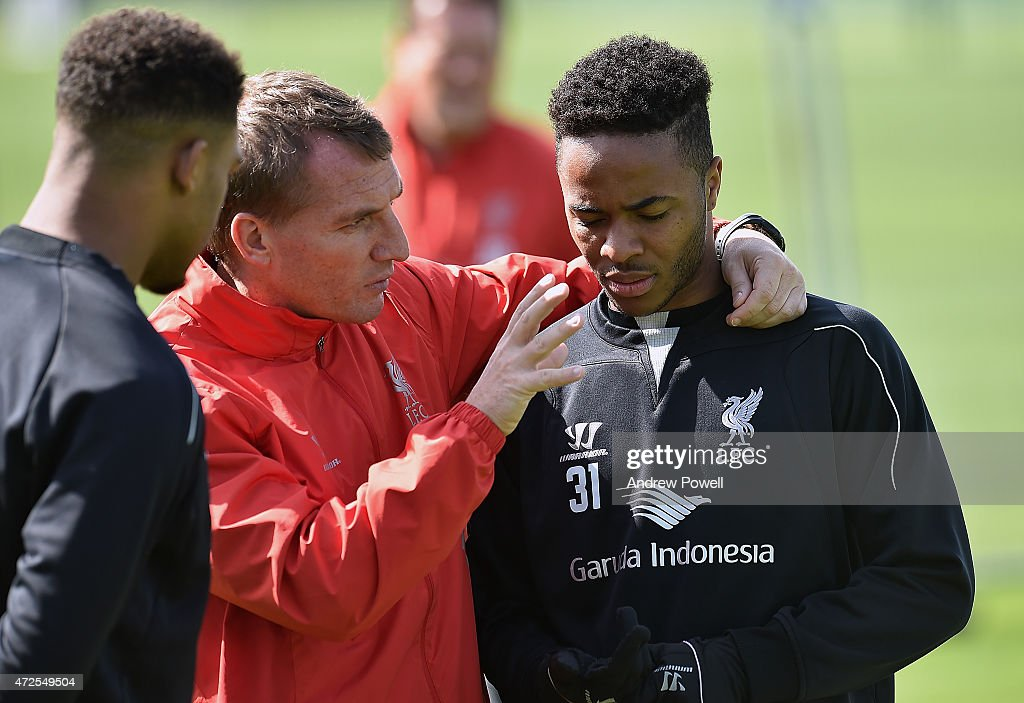 Brendan Rodgers manager of Liverpool talks with Raheem Sterling during a training session at Melwood Training Ground on May 8, 2015 in Liverpool, England.