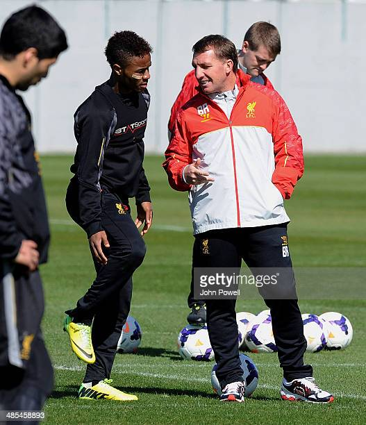 Brendan Rodgers manager of Liverpool talks with Raheem Sterling during a training session at Melwood Training Ground on April 18 2014 in Liverpool...