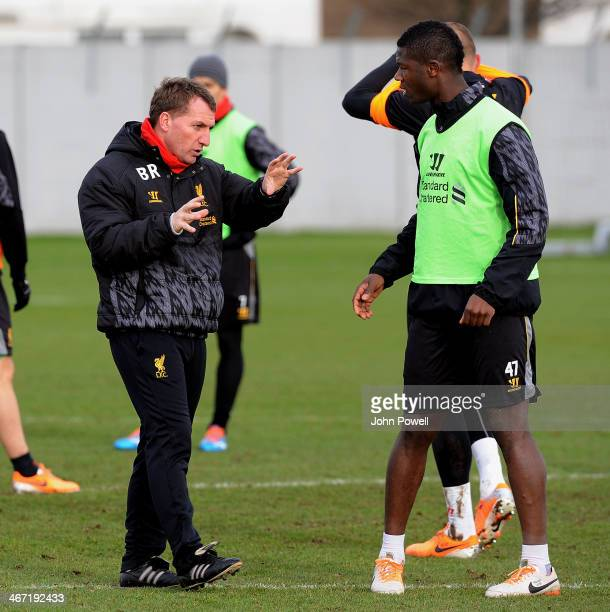 Brendan Rodgers manager of Liverpool talks with Stephen Sama during a training session at Melwood Training Ground on February 6 2014 in Liverpool...