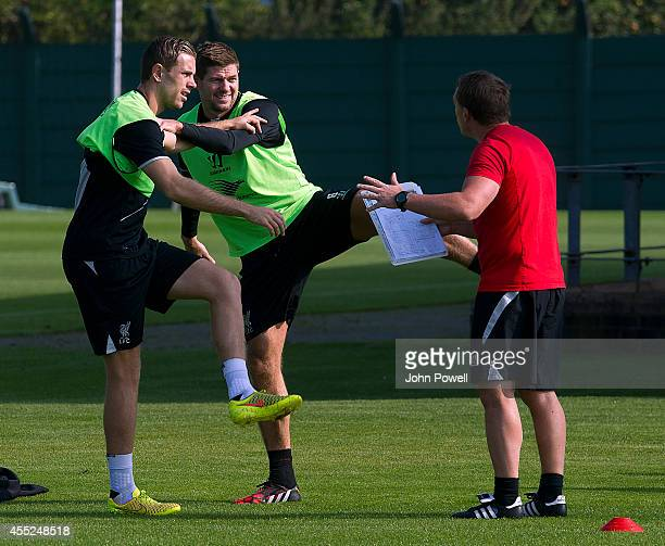 Brendan Rodgers manager of Liverpool talks with Steven Gerrard and Jordan Henderson during a training session at Melwood Training Ground on September...
