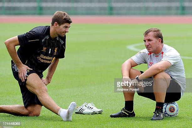 Brendan Rodgers manager of Liverpool talks with Steven Gerrard during a training session on July 26 2013 in Bangkok Thailand