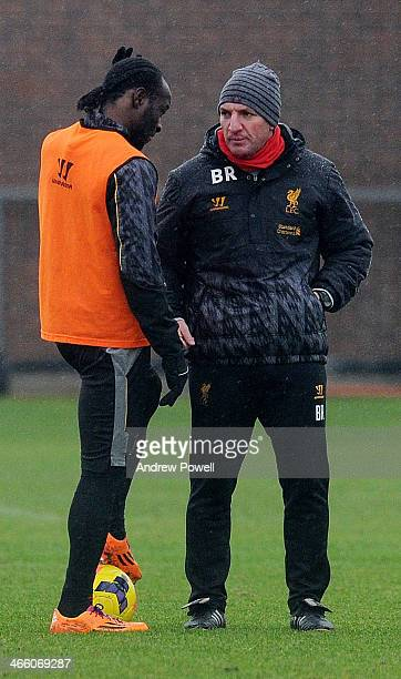 Brendan Rodgers manager of Liverpool talks with Victor Moses of Liverpool during a training session at Melwood Training Ground on January 31 2014 in...