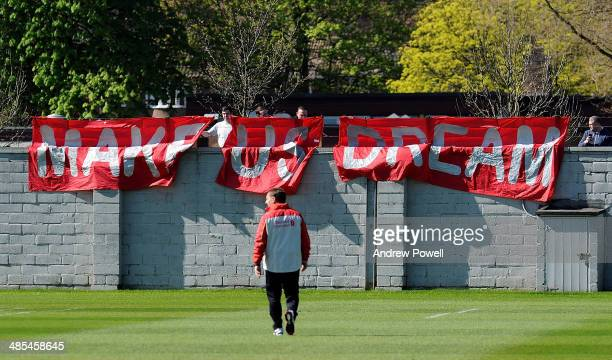 Brendan Rodgers manager of Liverpool walks over to fans who have displayed a banner with the message 'Make Us Dream' during a training session at...