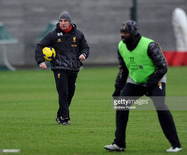Brendan Rodgers manager of Liverpool watches his players during a training session at Melwood Training Ground on January 31 2014 in Liverpool England