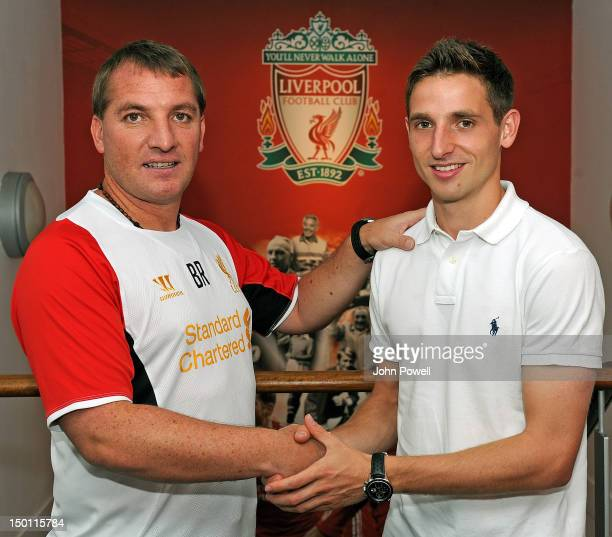 Brendan Rodgers Manager of Liverpool with his new signing Joe Allen of Liverpool today at Melwood Training Ground on August 10 2012 in Liverpool...