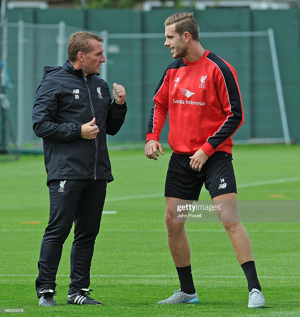 Brendan Rodgers Manager of Liverpool with Jordan Henderson of Liverpool during a Liverpool FC training session at Melwood Training Ground on July 28, 2015 in Liverpool, England.