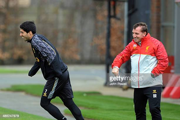 Brendan Rodgers manager of Liverpool with Luis Suarez of Liverpool during a training session at Melwood Training Ground on April 17 2014 in Liverpool...