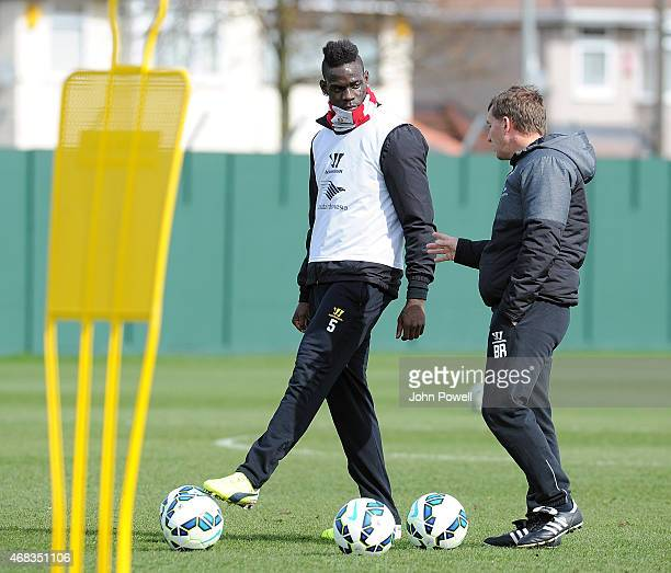 Brendan Rodgers of Liverpool with Mario Balotelli during a training session at Melwood Training Ground on April 2 2015 in Liverpool England