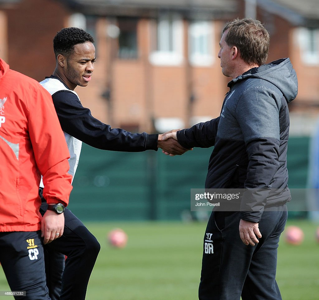 Brendan Rodgers of Liverpool with Raheem Sterling during a training session at Melwood Training Ground on April 2, 2015 in Liverpool, England.