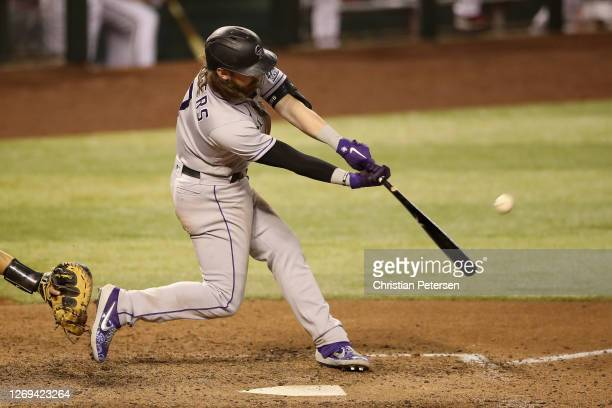 Brendan Rodgers of the Colorado Rockies bats against the Arizona Diamondbacks during the MLB game at Chase Field on August 26 2020 in Phoenix Arizona