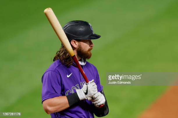 Brendan Rodgers of the Colorado Rockies bats during the eighth inning against the Houston Astros at Coors Field on August 19 2020 in Denver Colorado...