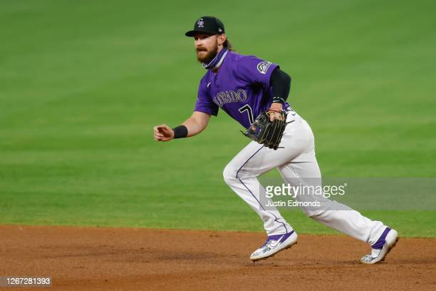 Brendan Rodgers of the Colorado Rockies defends on the play during the eighth inning against the Houston Astros at Coors Field on August 19, 2020 in...