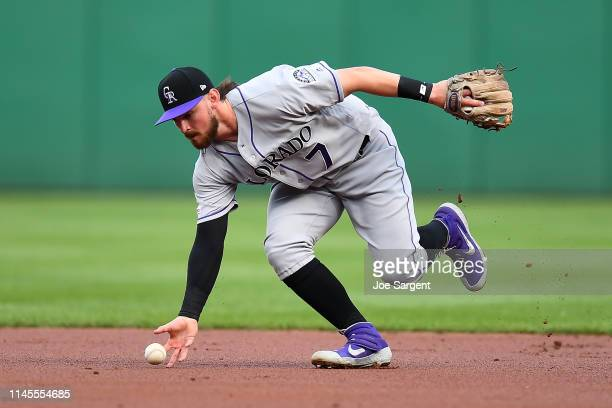 Brendan Rodgers of the Colorado Rockies fields a ball hit by Adam Frazier of the Pittsburgh Pirates during the first inning at PNC Park on May 7,...