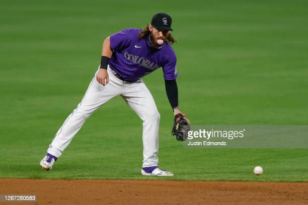 Brendan Rodgers of the Colorado Rockies fields a ground ball while warming up during the eighth inning against the Houston Astros at Coors Field on...
