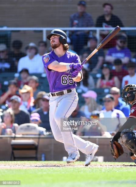 Brendan Rodgers of the Colorado Rockies follows through on a swing during a spring training game against the Arizona Diamondbacks at Salt River...