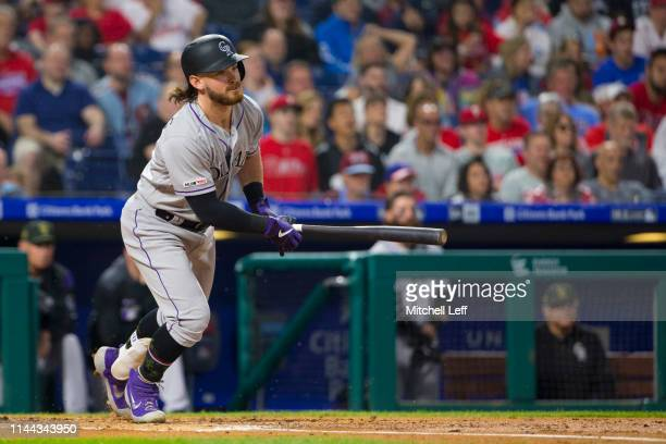 Brendan Rodgers of the Colorado Rockies hits a fielders choice RBI in his first major league at bat in the top of the second inning against the...