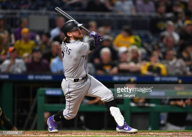 Brendan Rodgers of the Colorado Rockies hits an RBI double in the fifth inning against the Pittsburgh Pirates at PNC Park on May 22, 2019 in...