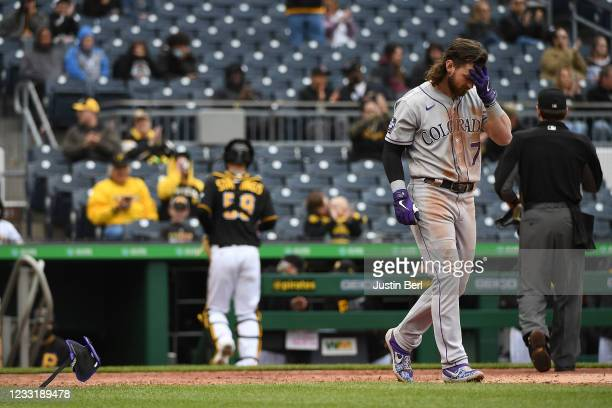 Brendan Rodgers of the Colorado Rockies reacts after striking out with the bases loaded in the sixth inning during the game against the Pittsburgh...