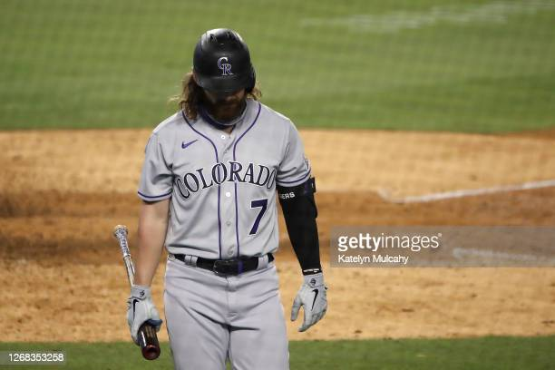 Brendan Rodgers of the Colorado Rockies walks to the dugout after striking out during the eighth inning against the Los Angeles Dodgers at Dodger...