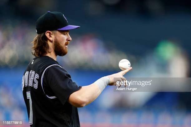 Brendan Rodgers of the Colorado Rockies warms up prior to taking on the New York Mets at Citi Field on June 8, 2019 in the Flushing neighborhood of...