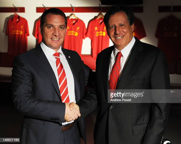 Brendan Rodgers poses for pictures with Liverpool FC owner Tom Werner as he is officially unveiled as new manager of Liverpool FC at Anfield on June...