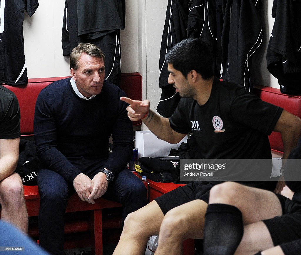 Brendan Rodgers talks with Luis Suarez in the dressing room before the Liverpool All Star Charity Match at Anfield on March 29, 2015 in Liverpool, England.