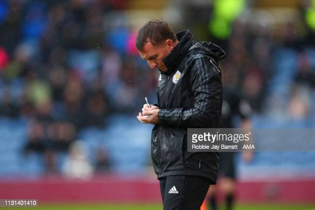 Brendan Rodgers the head coach / manager of Leicester City takes notes during the Premier League match between Burnley FC and Leicester City at Turf...